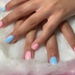 A woman with pink and blue colored nails